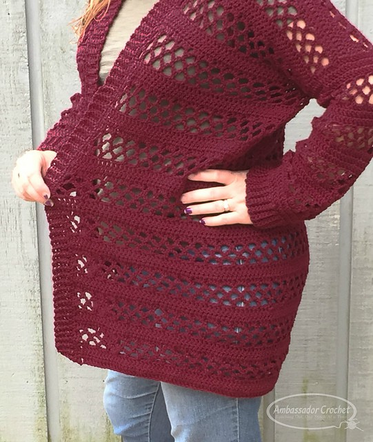 A close up of a maroon colored crochet cardigan, called the Magnolia Cardigan.