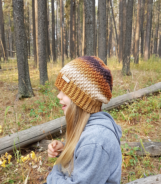 Girl wearing a crochet slouch hat, called the Savannah Slouch.