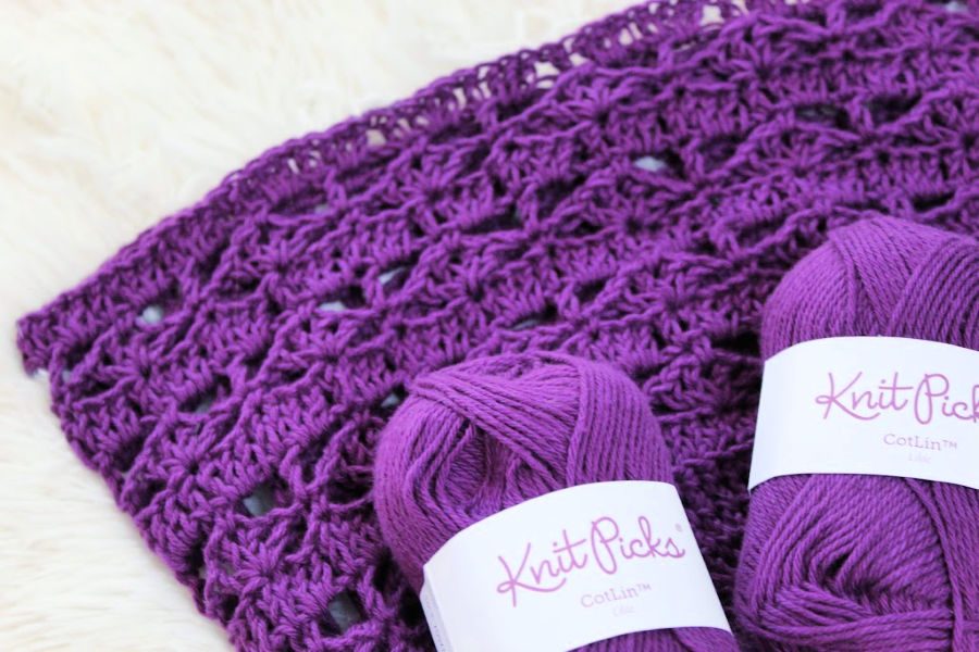 Knit Picks Cotlin Yarn  in the color Lilac laid on top of the Calla Lily Market Bag to display the gorgeous color of the yarn.
