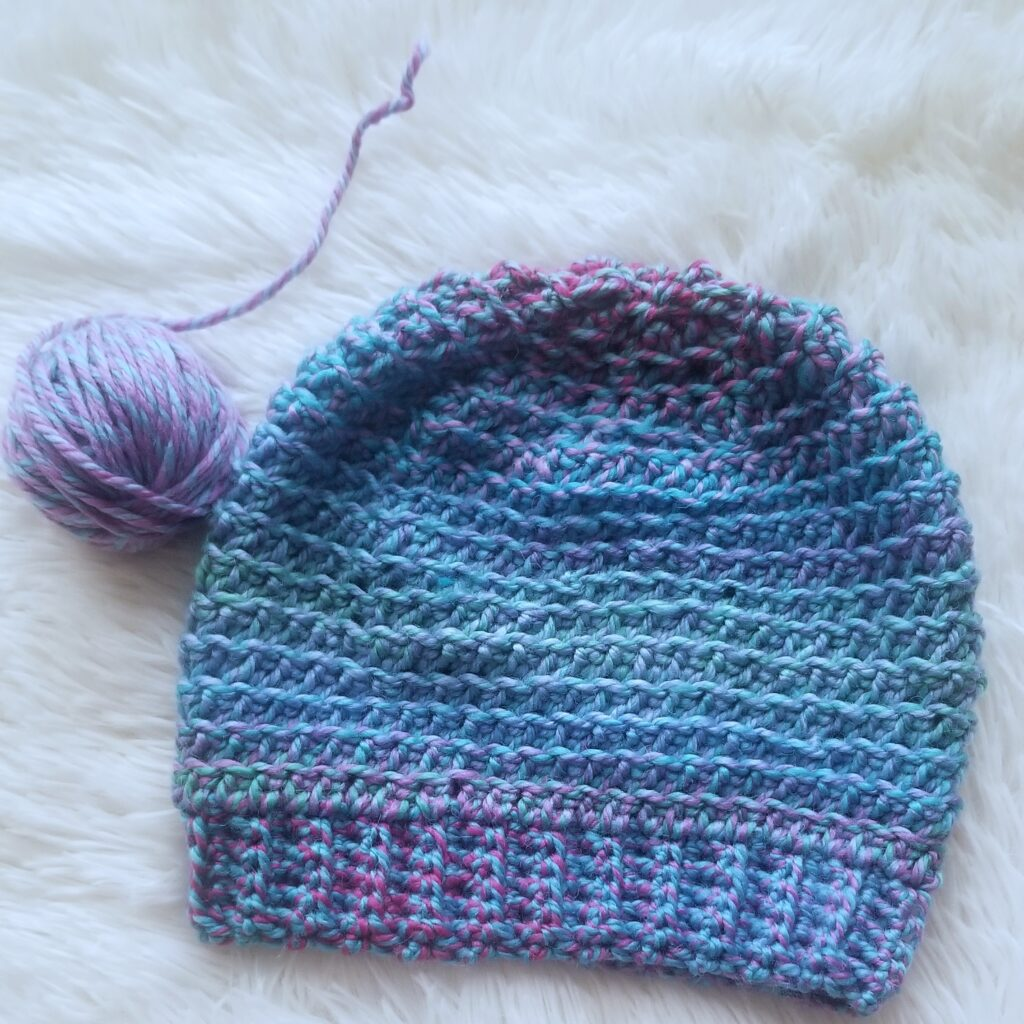 Flatlay of blue and pink KJ Hat.