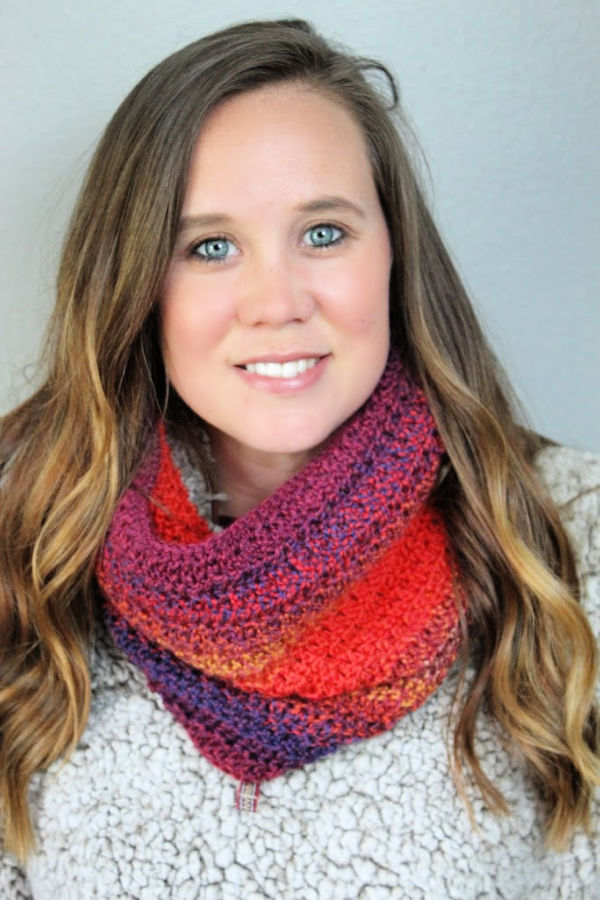 Woman wearing the Edgewater Cowl made in Knit Picks Chroma Twist Worsted yarn.
