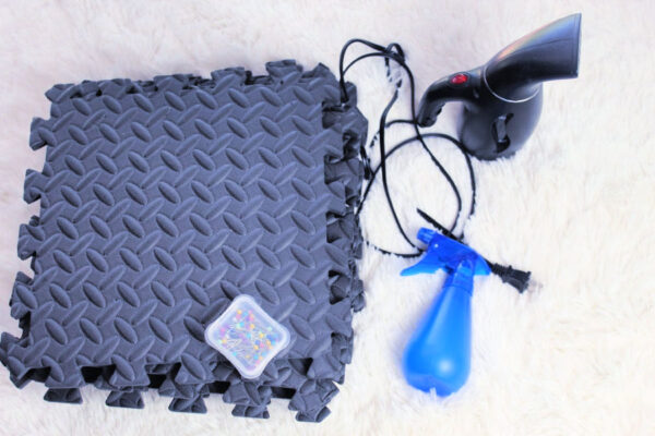 Crochet Blocking Tools including foam mats, pins, steamer, and spray bottle.