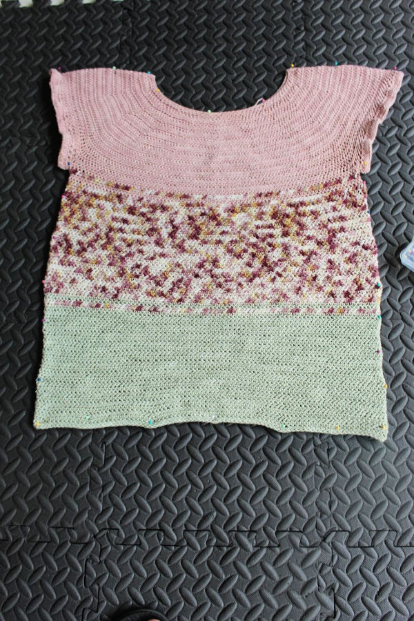 Photo of crocheted top pinned to foam blocking mats and ready to be blocked.