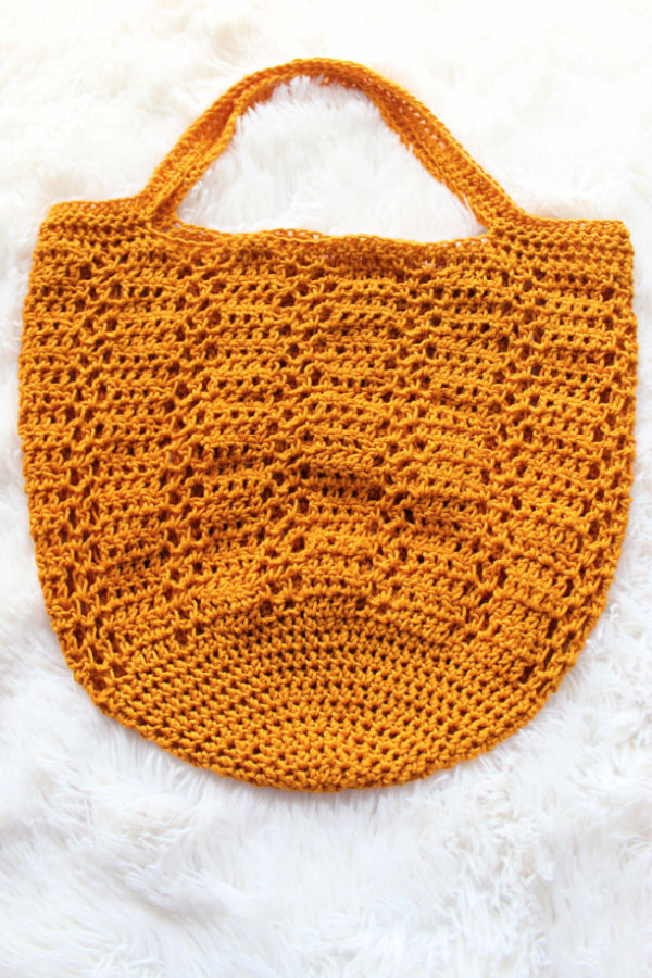 Yellow crochet bag called the Sabre Bag.