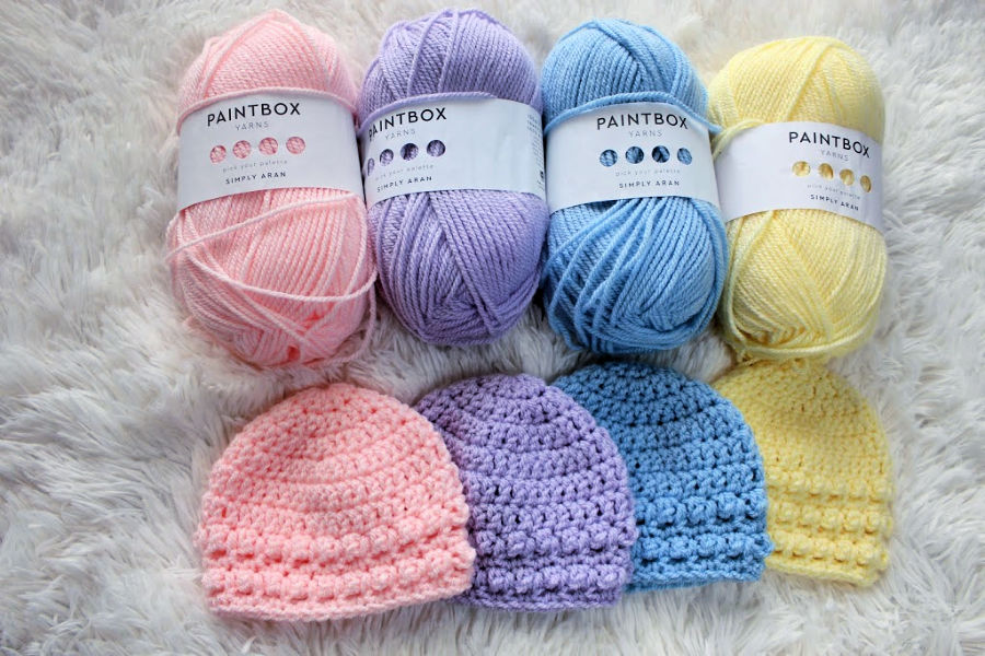 Paintbox yarns with Little Textures Newborn Beanie hats laid flat.
