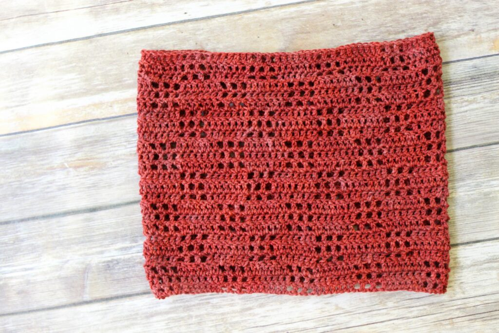 Red Filet Crochet Cowl laid flat.