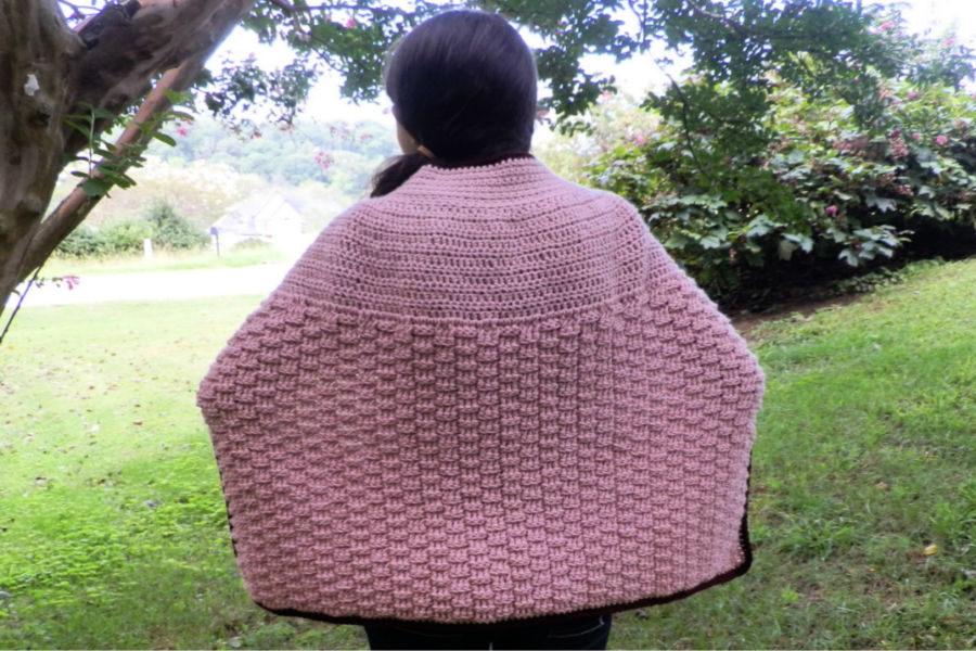 Photo of the back part of the crochet cape, called the Enchanted Dreams Cape, featuring the tri-square crochet stitch.