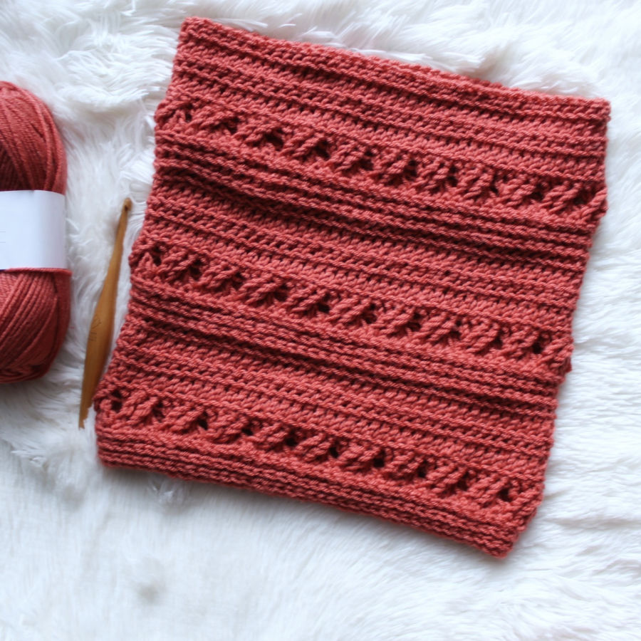 Flat lay of crochet cowl pattern, called the Catherine Cowl.