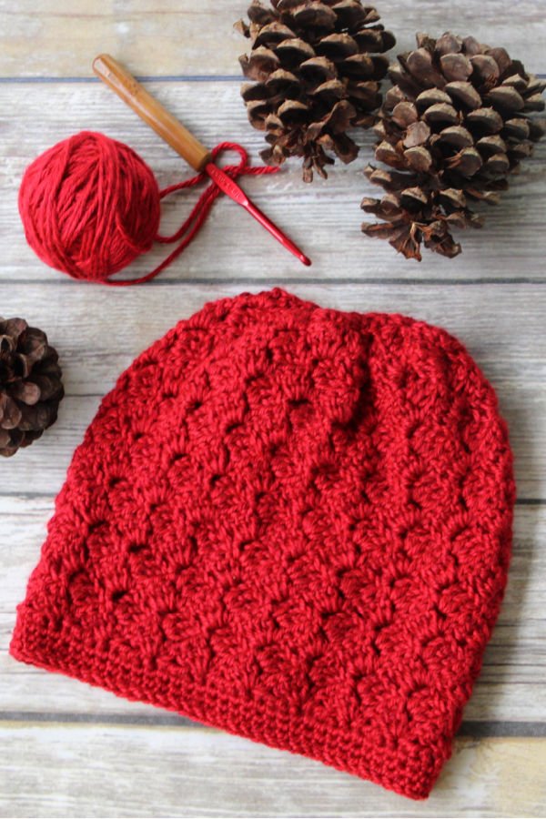 Flat lay of red crocheted slouchy hat, called the Dallas Hat.