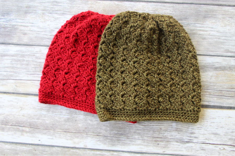 Two crochet slouchy hats, one in green and one in red. This hat is called the Dallas Hat.