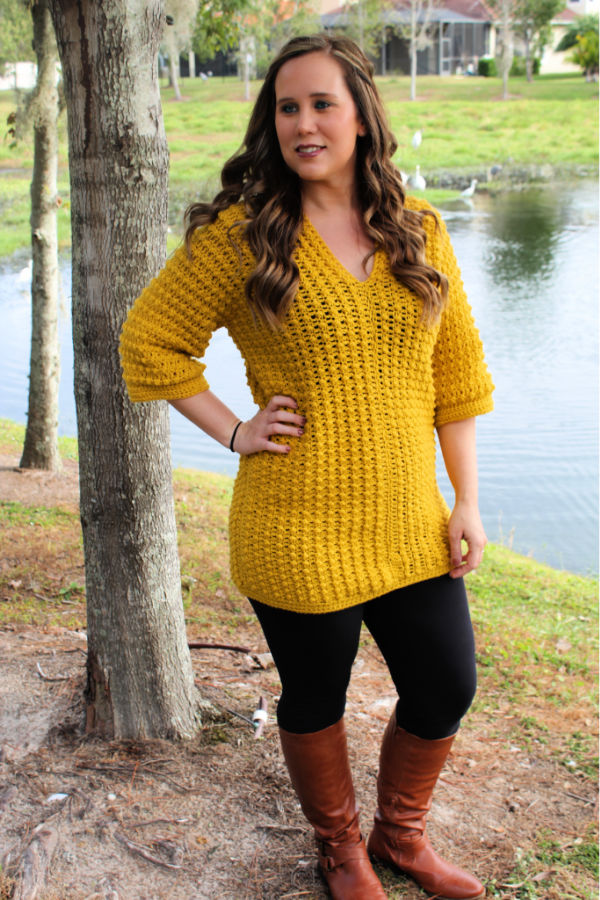 Woman wearing a yellow crochet tunic called the Tuscan Sun Tunic.