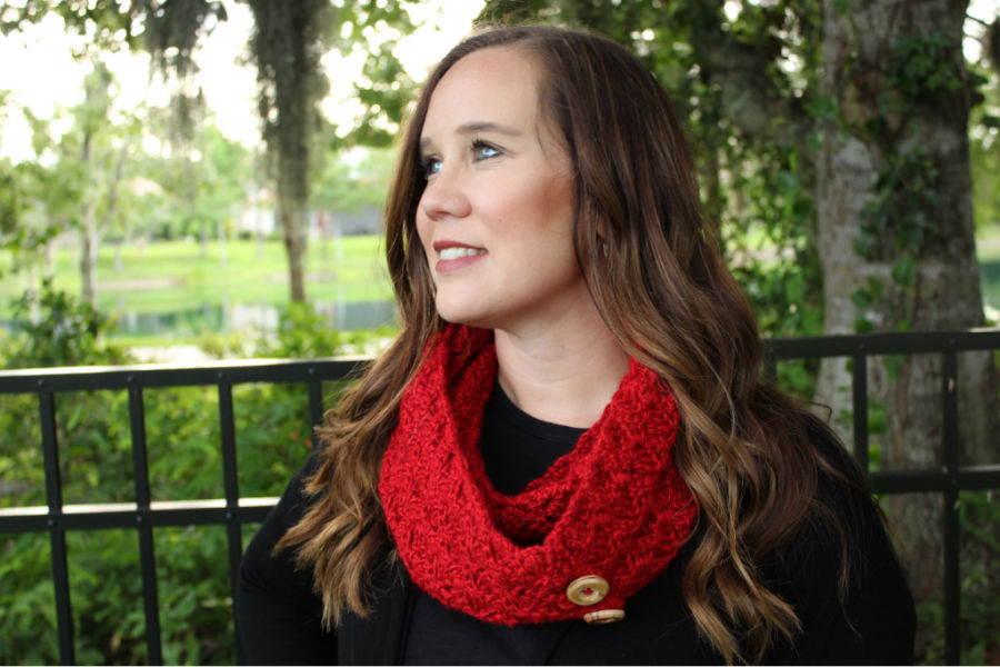 Woman wearing red crochet infinity scarf called the Dallas Scarf.