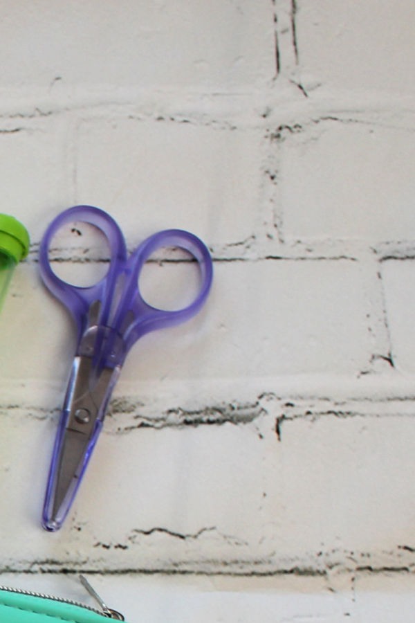 A close up of scissors, used for cutting yarn when crocheting.