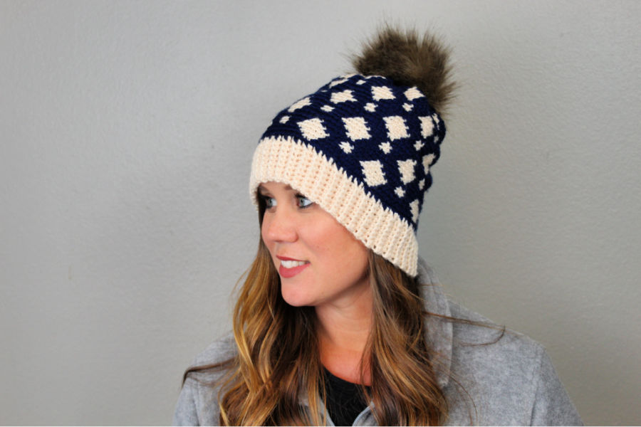 Woman wearing a fair isle crochet blue and cream hat, called the Gatlinburg Hat.