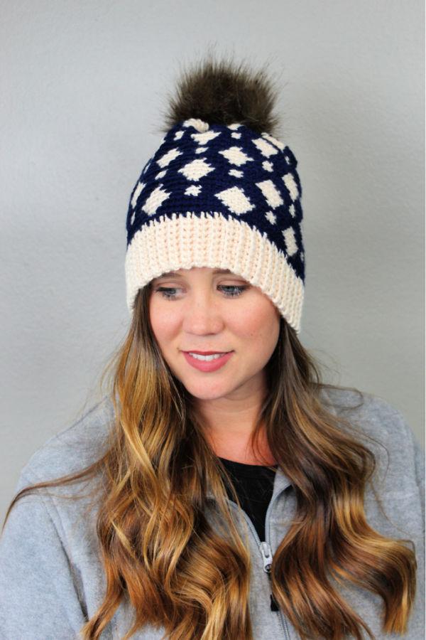 Woman wearing a fair isle crochet hat, called the Gatlinburg Hat.