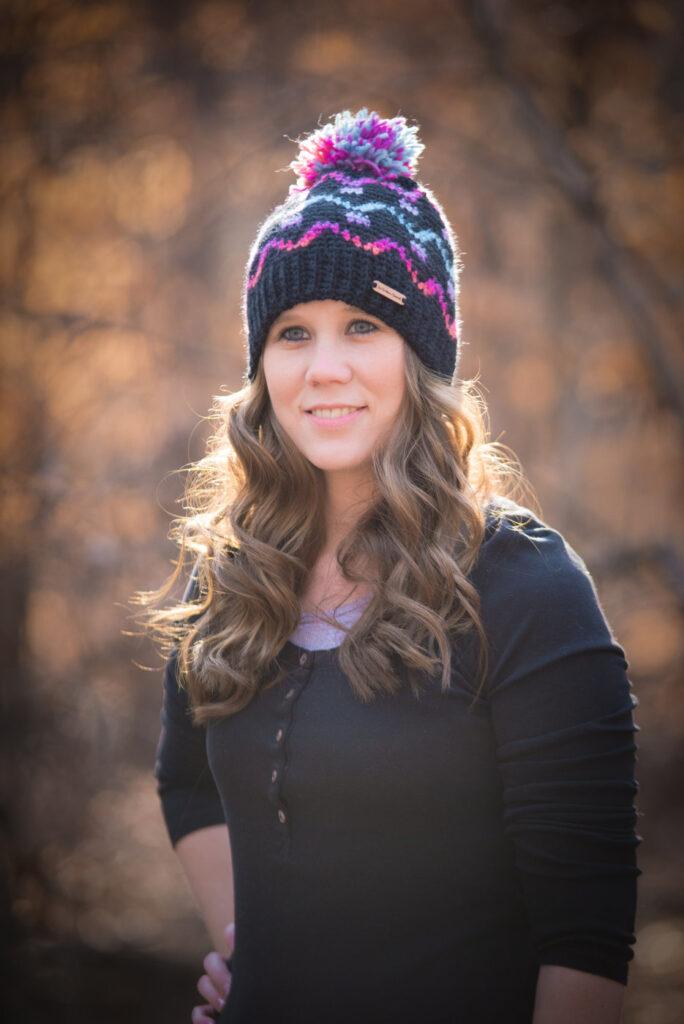 Woman wearing a fair isle crochet hat, called the Camden Hat.