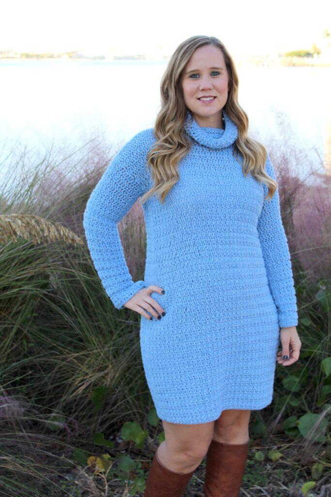 Woman wearing blue crochet dress called the Edgewater Sweater Dress.