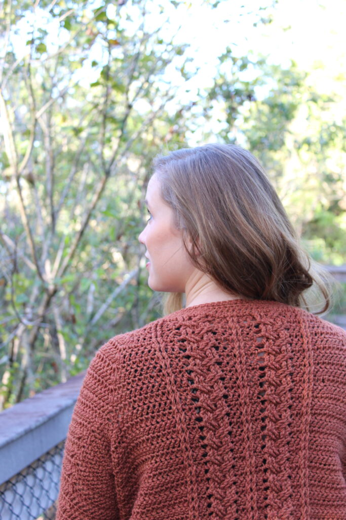 Close up of the Aspen Crochet Cardigan cable stitches on the back.