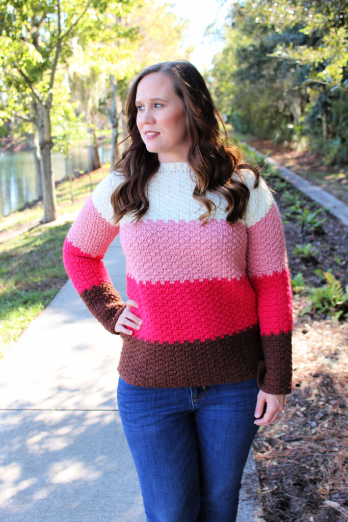 Woman wearing color block crochet sweater called the Michelle Sweater.