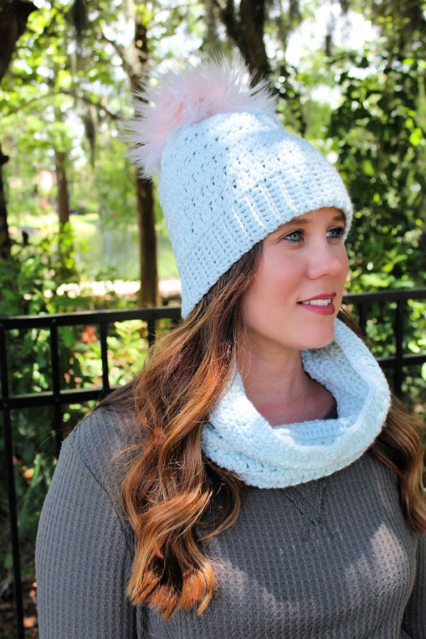 Woman wearing a crochet hat and cowl set, called the Rory Hat and Cowl.