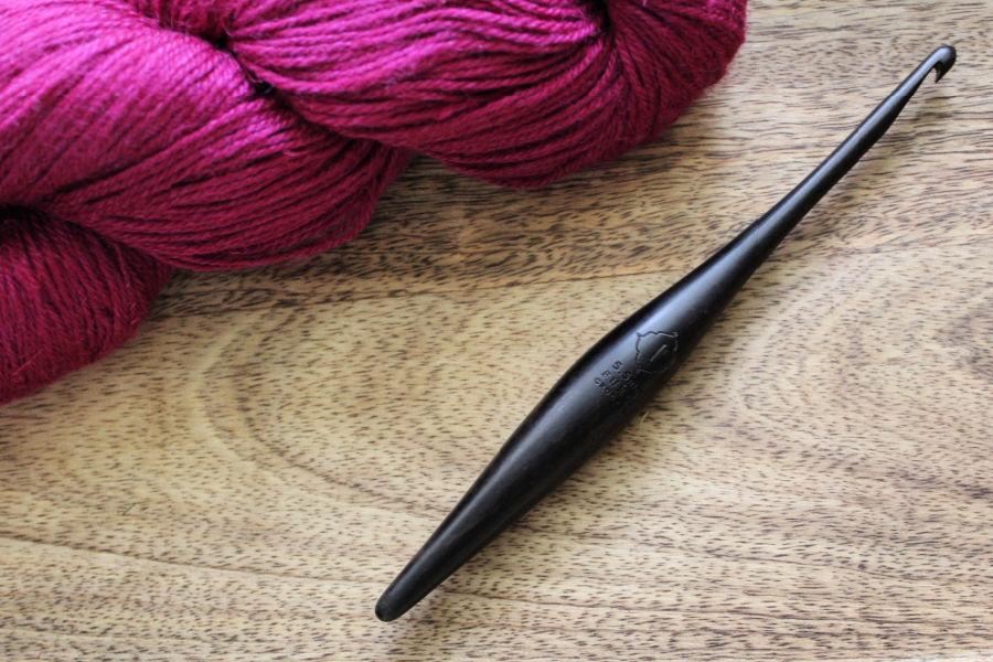 Furls Streamline Crochet Hook in the Ebony wood.