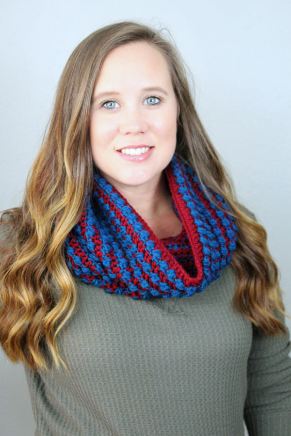 Woman wearing a crochet cowl called the Tuscan Sun Cowl.