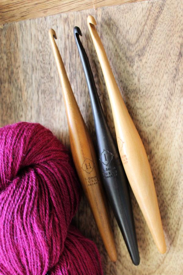 Furls Streamline Crochet Hooks in Teak, Ebony, and Camwood.