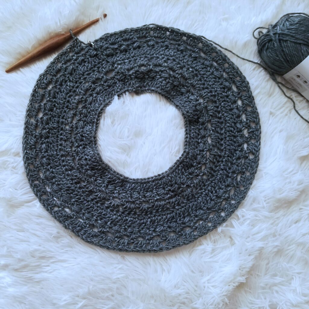 Flat lay of the yoke of the crochet sweater called the Brimstone Sweater.