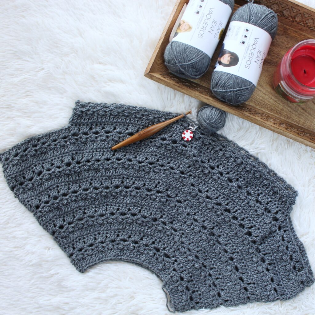 Flat lay of a progress shot of the crochet sweater, called the Brimstone Sweater.