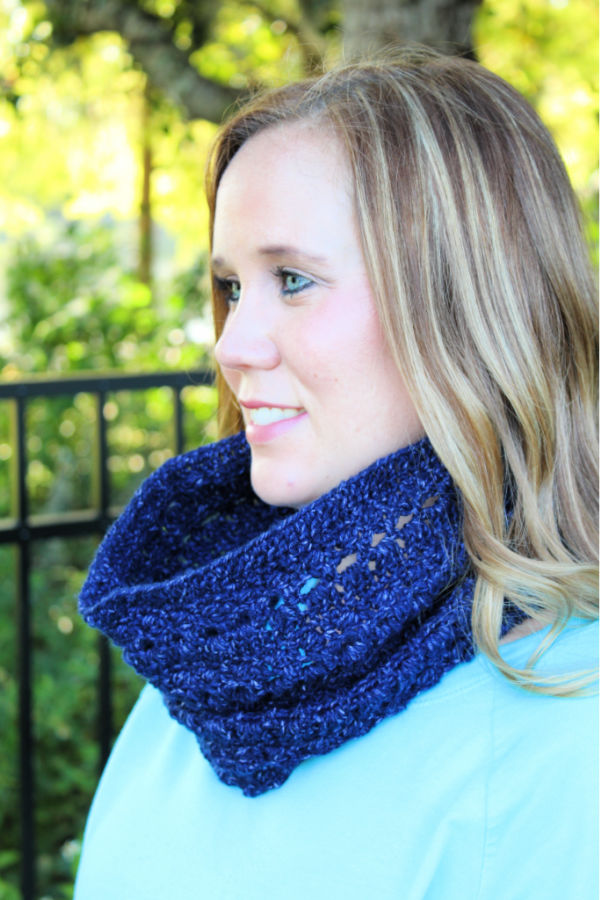 Woman wearing a blue crochet cowl, called the Brimstone Cowl.