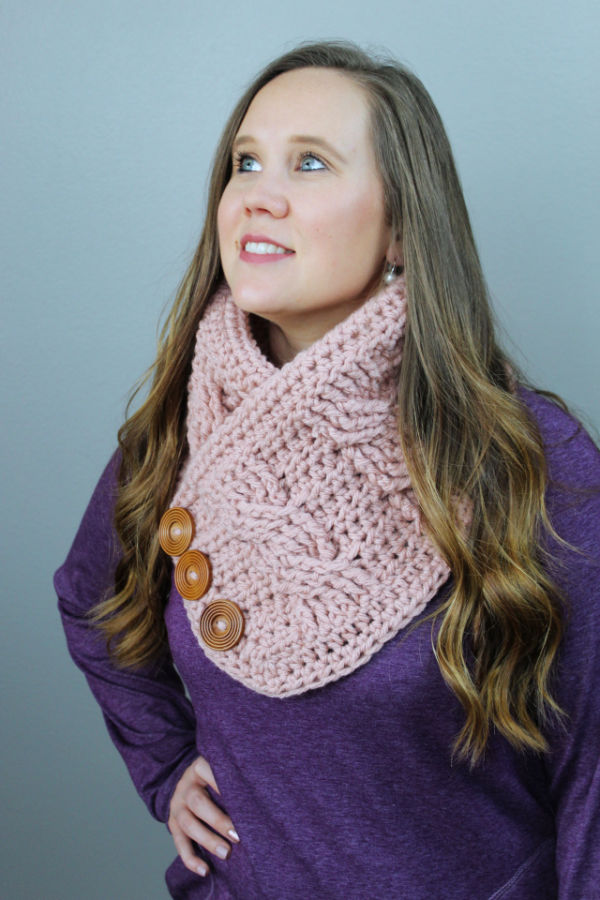 Woman wearing a pink crochet cowl, called the Alexis Cowl.