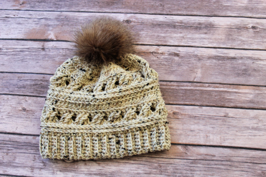 Flat lay of crochet hat, called the Catherine Hat.