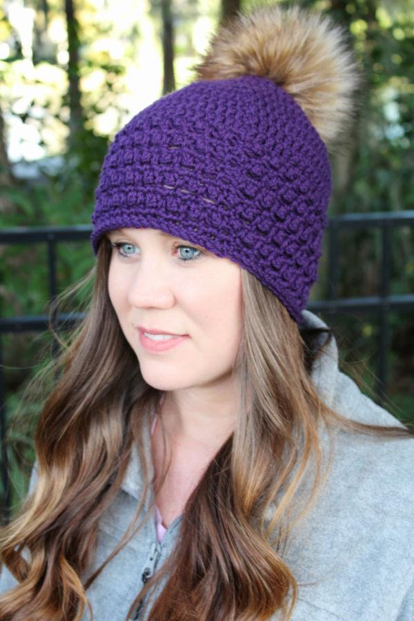 Woman wearing a purple crochet beanie called the Little Textures Beanie.