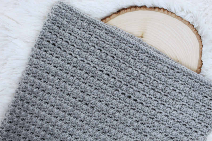 Flat lay photo of a gray hooded cowl, called the Little Textures Hooded Cowl.