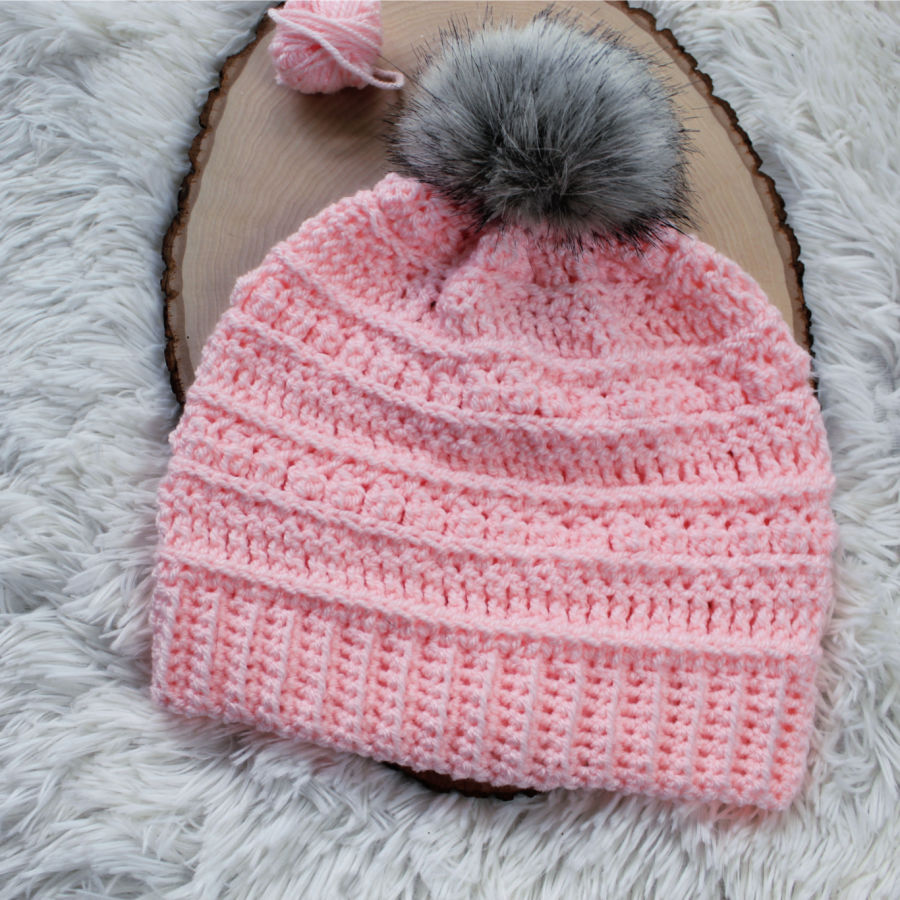Light Pink crochet beanie with gray pom. This beanie is called the Bobble Ridge Beanie.