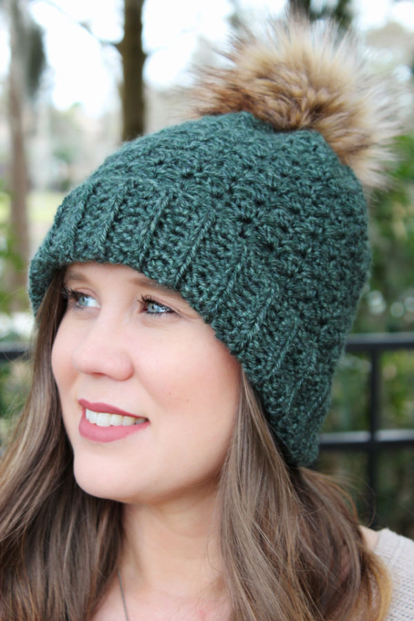 Close up of green crochet hat, called the Ferguson Hat.