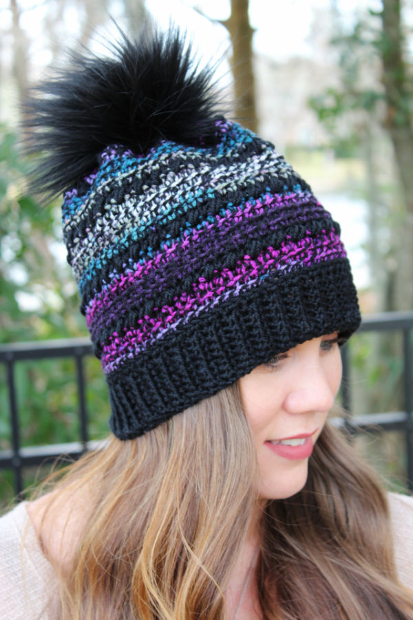Woman wearing a crochet hat called the CC Hat.