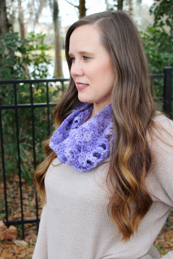Woman wearing a light purple crochet cowl, called the Kellie Cowl.