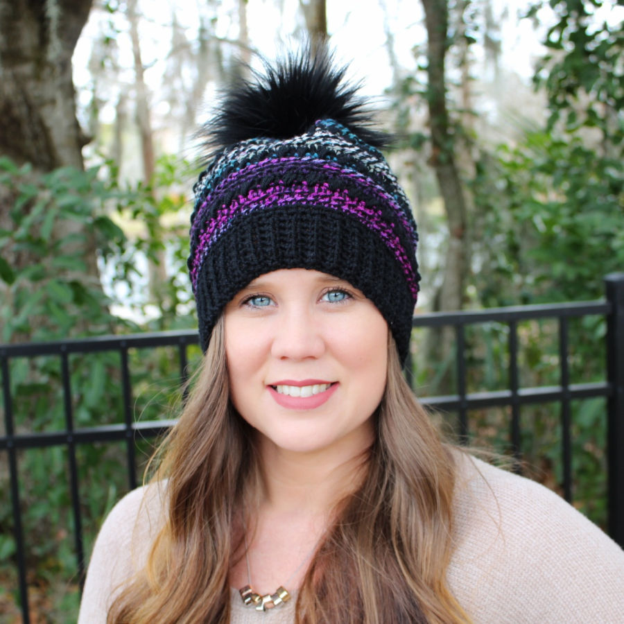 Front view of woman wearing a crochet hat, called the CC Hat.