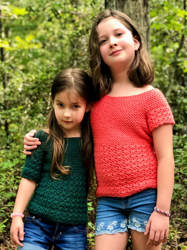 Two girls wearing different variations of a crochet top, called the Primrose Blouse.