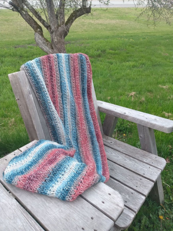 Crochet Beach Cover Up draped over a wooden chair.