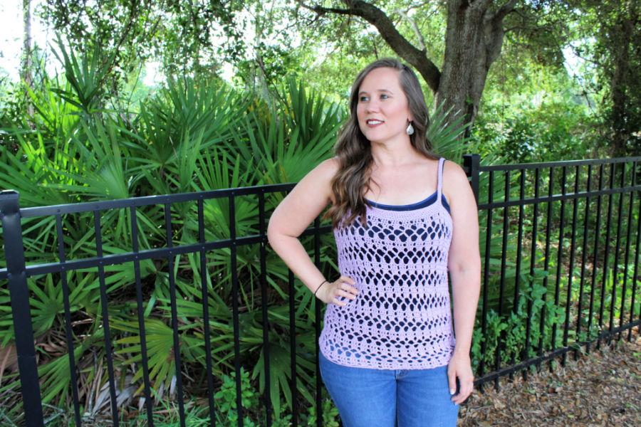 Woman wearing a light purple crochet tank top, called the Sarasota Tank.