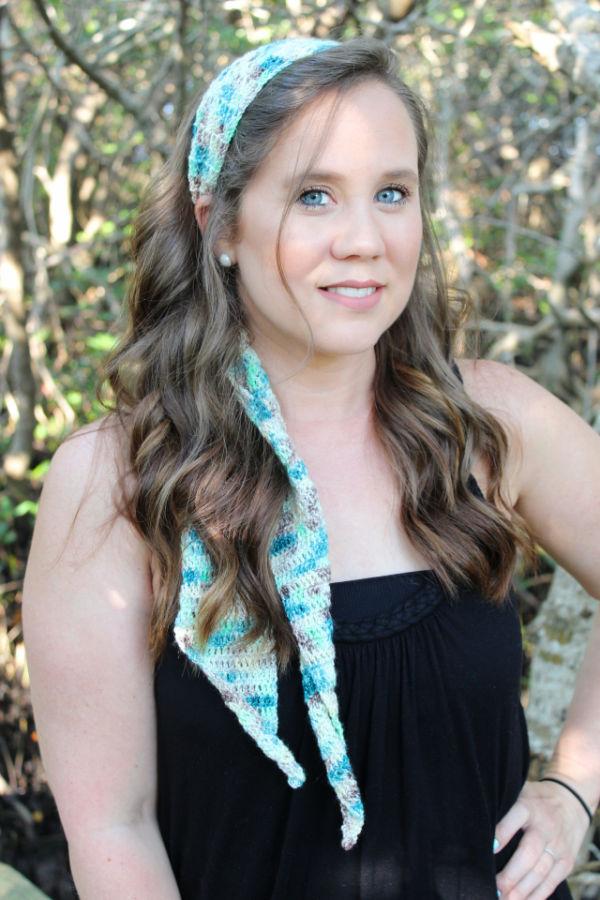 Woman wearing a crochet headband, called the Fiji Headband.
