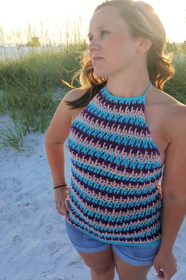 Woman wearing a crochet halter top, called the Beachy Babe Halter Top.