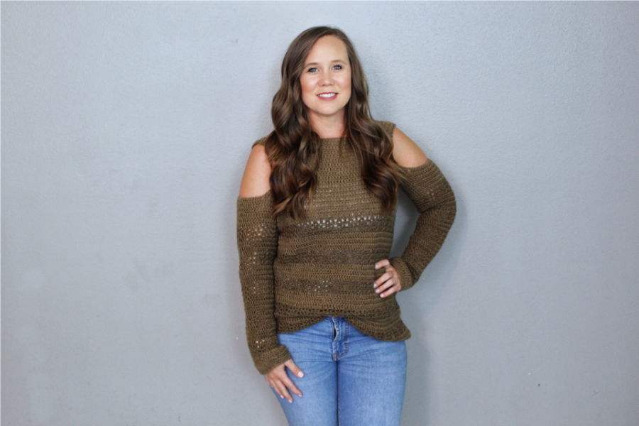 Woman wearing a crochet sweater called the Calgary Cold Shoulder Sweater.