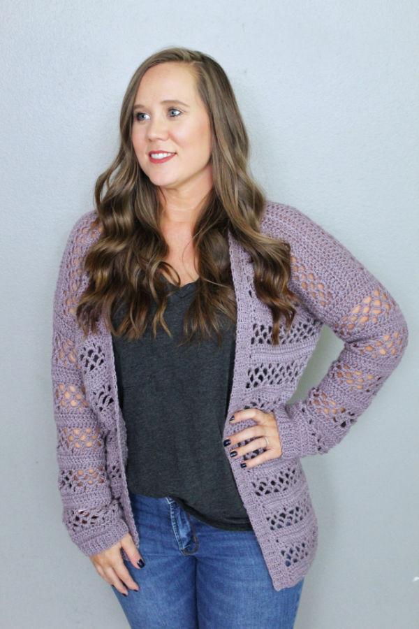 Woman wearing a crochet cardigan called the Magnolia Cardigan.