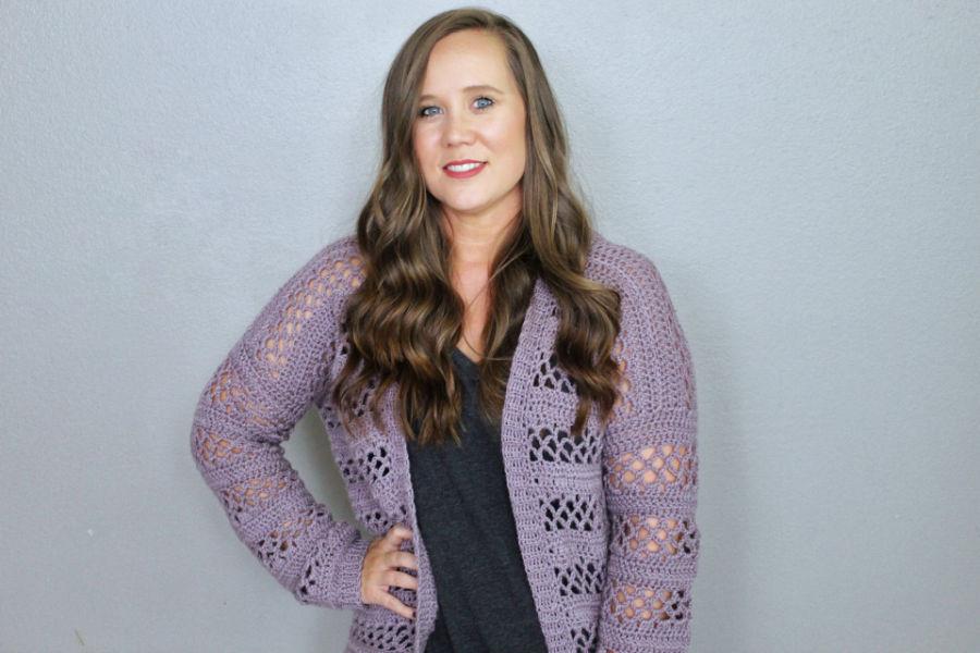 Woman wearing a light purple crochet cardigan called the Magnolia Cardigan.