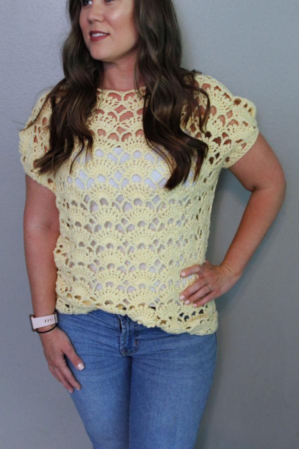 Woman wearing a yellow crochet top, called the Santa Rosa Tee.