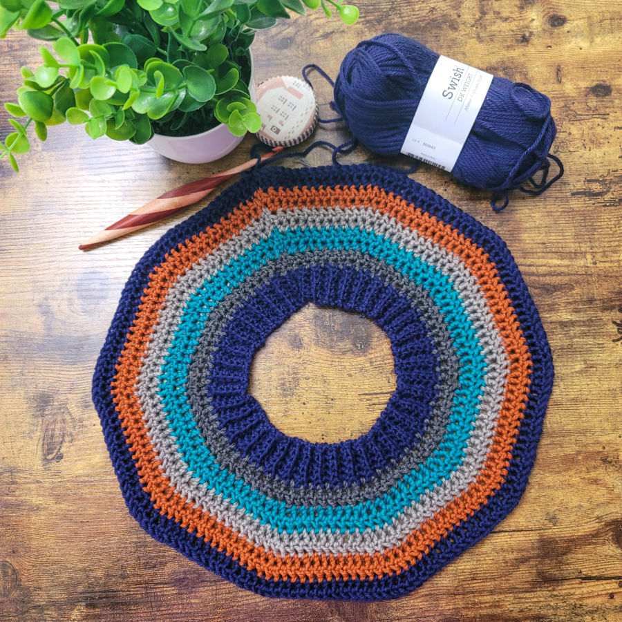 Flat lay photo of the yoke of the Vinnie Sweater crochet pattern.