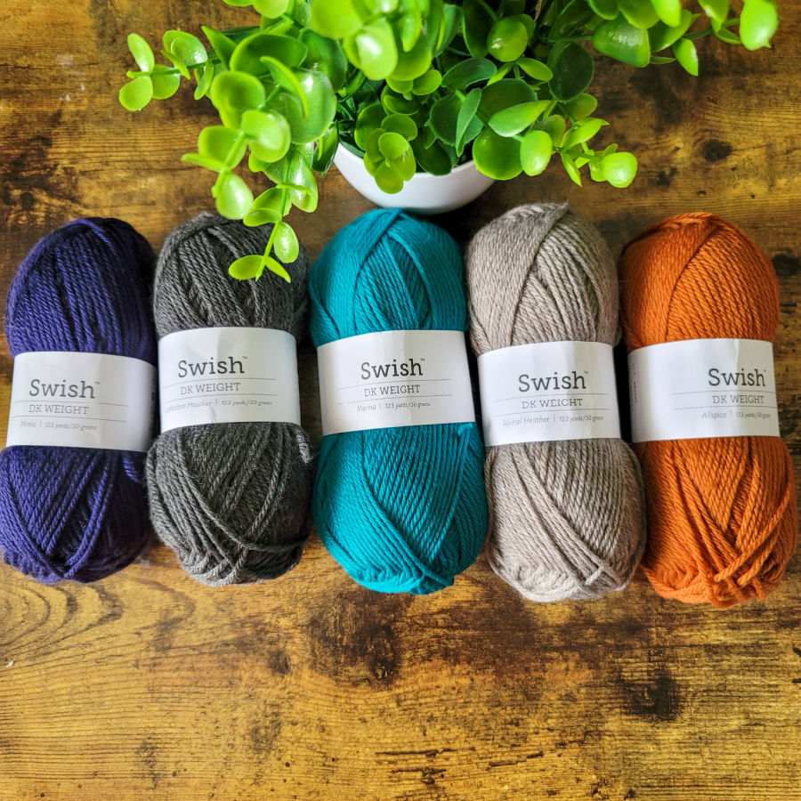 Photo of the 5 colors of yarn used to make the Vinnie Sweater.